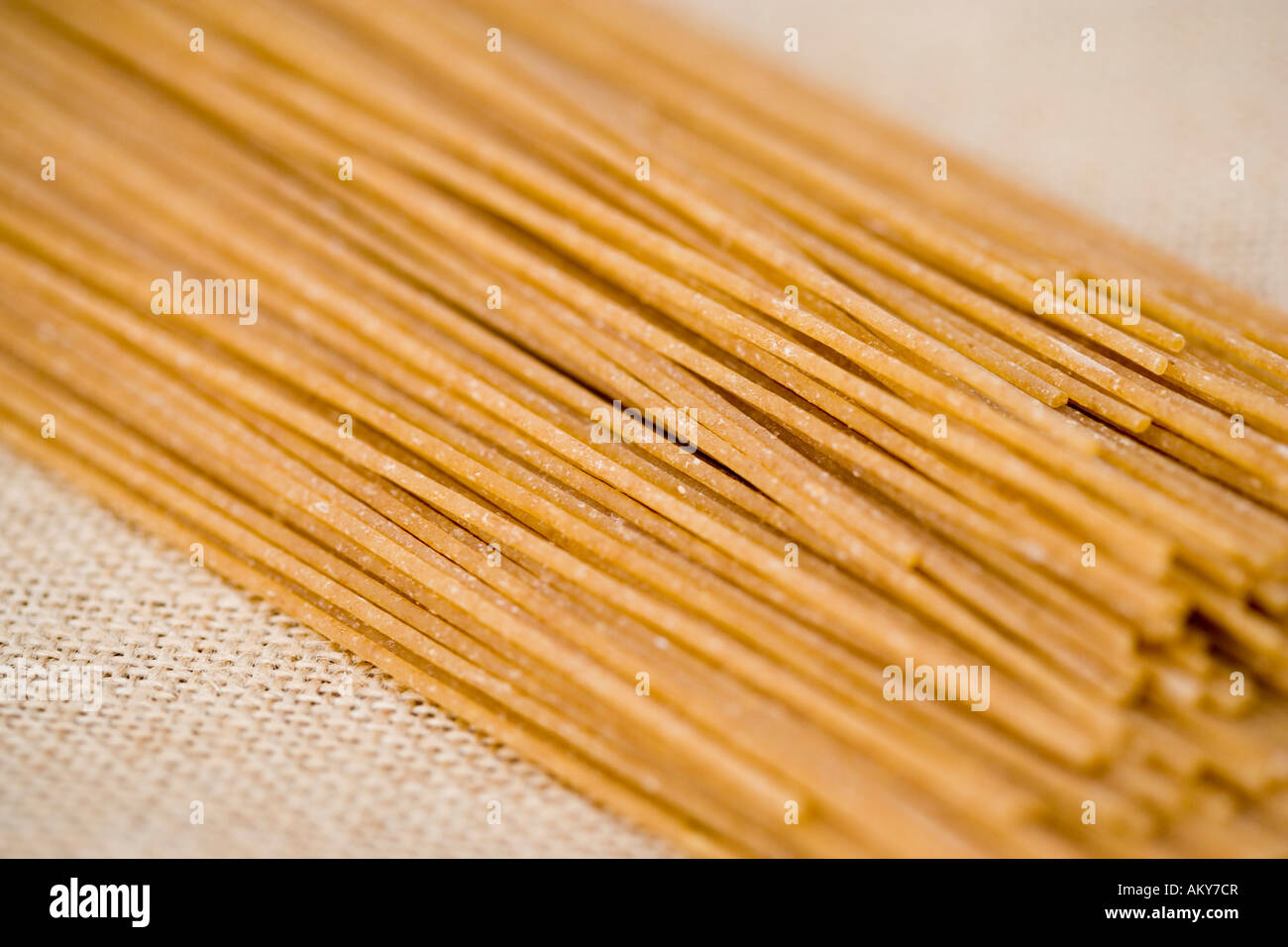 Wholewheat dry spaghetti pasta in detailed close up - Stock Image