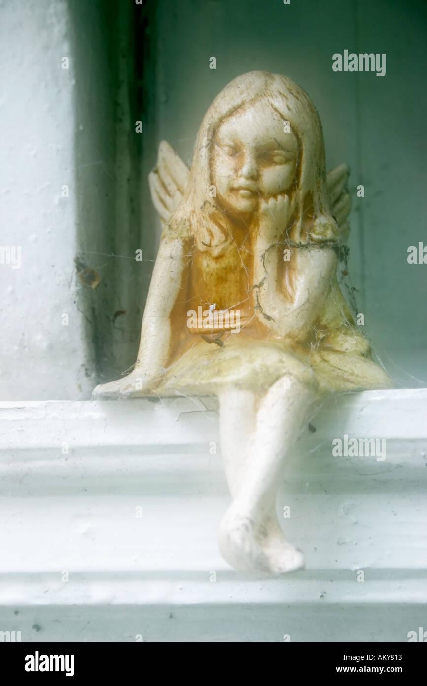 Model of Fairy on window ledge - Stock Image