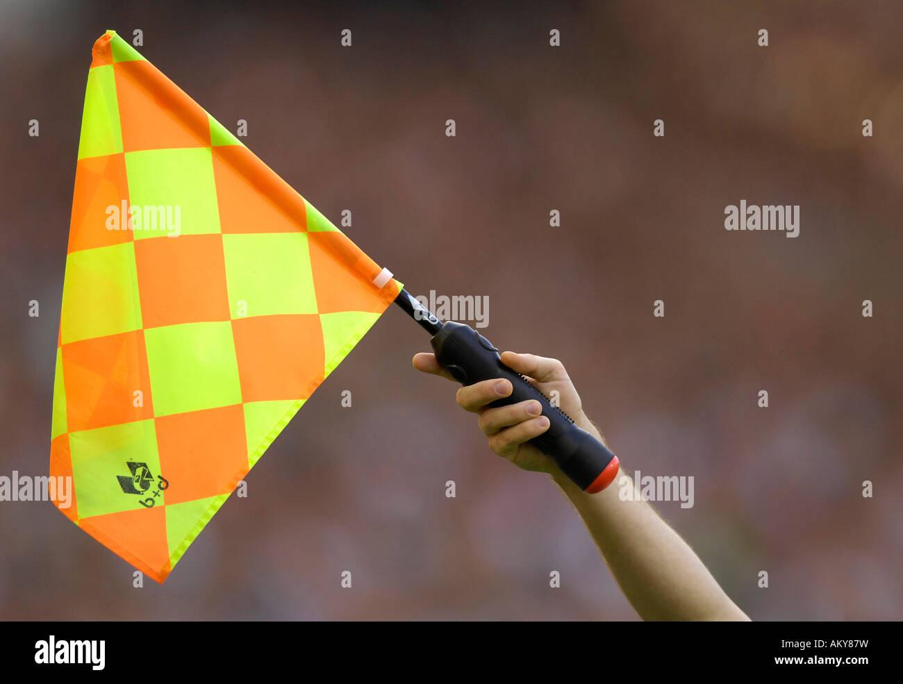 Linesman with flag - Stock Image