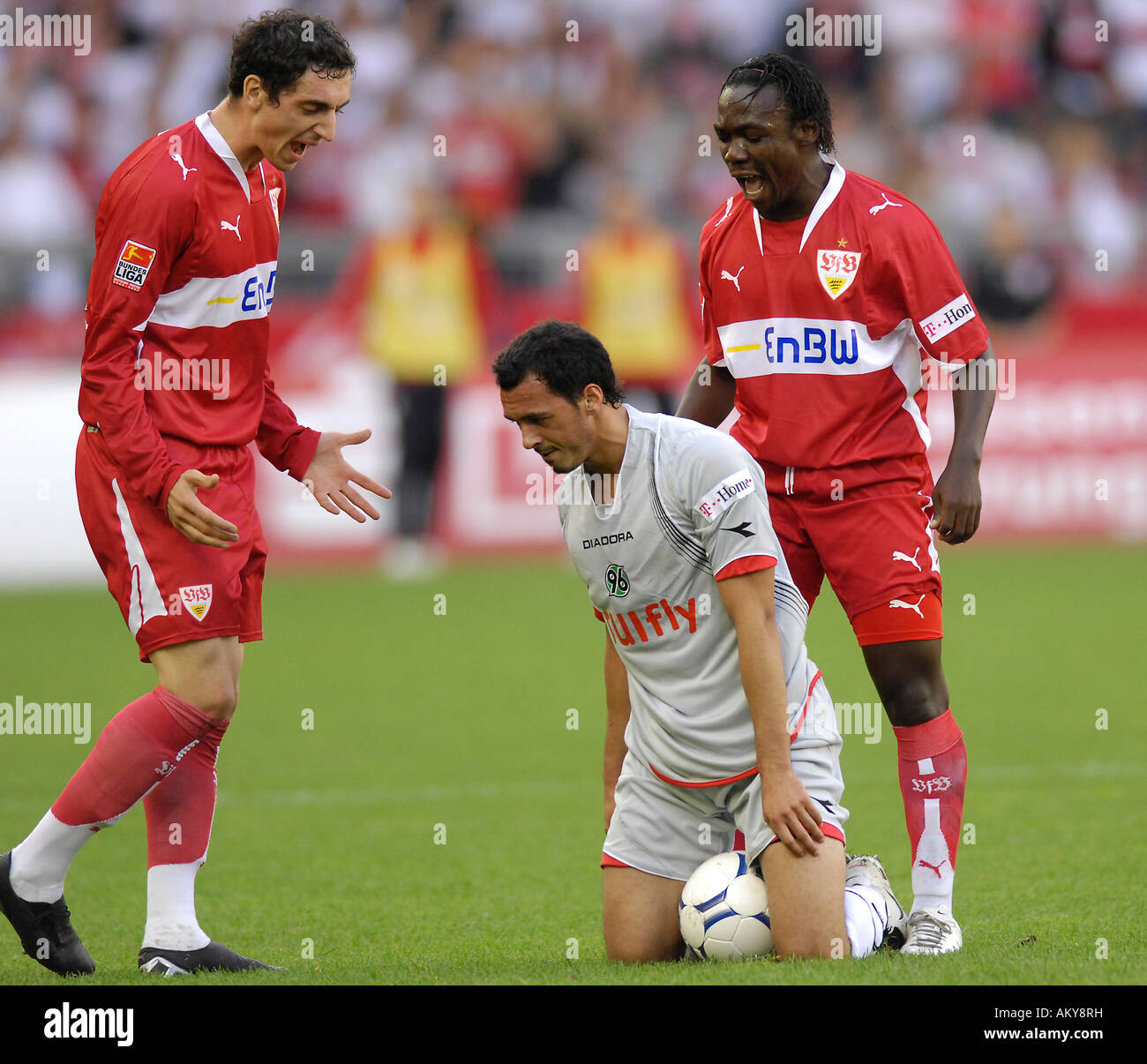 Roberto HILBERT VfB Stuttgart (left) and Arthur BOKA (right) shouting at Altin LALA Hannover 96 (middle) - Stock Image
