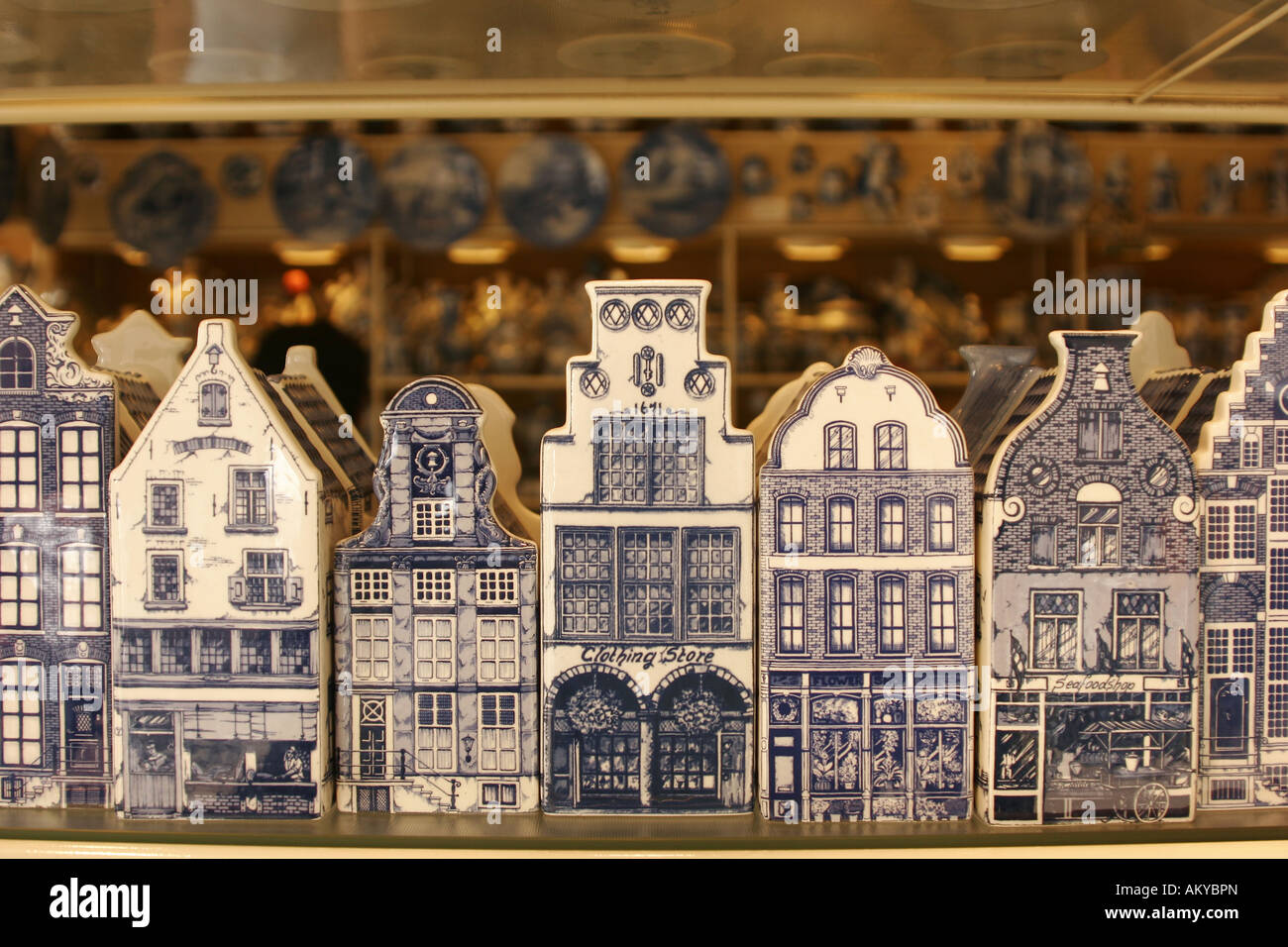 Typical dutch houses made of pottery as souvenirs from Delft . Delftware , or Delft pottery , is traditional blue - Stock Image