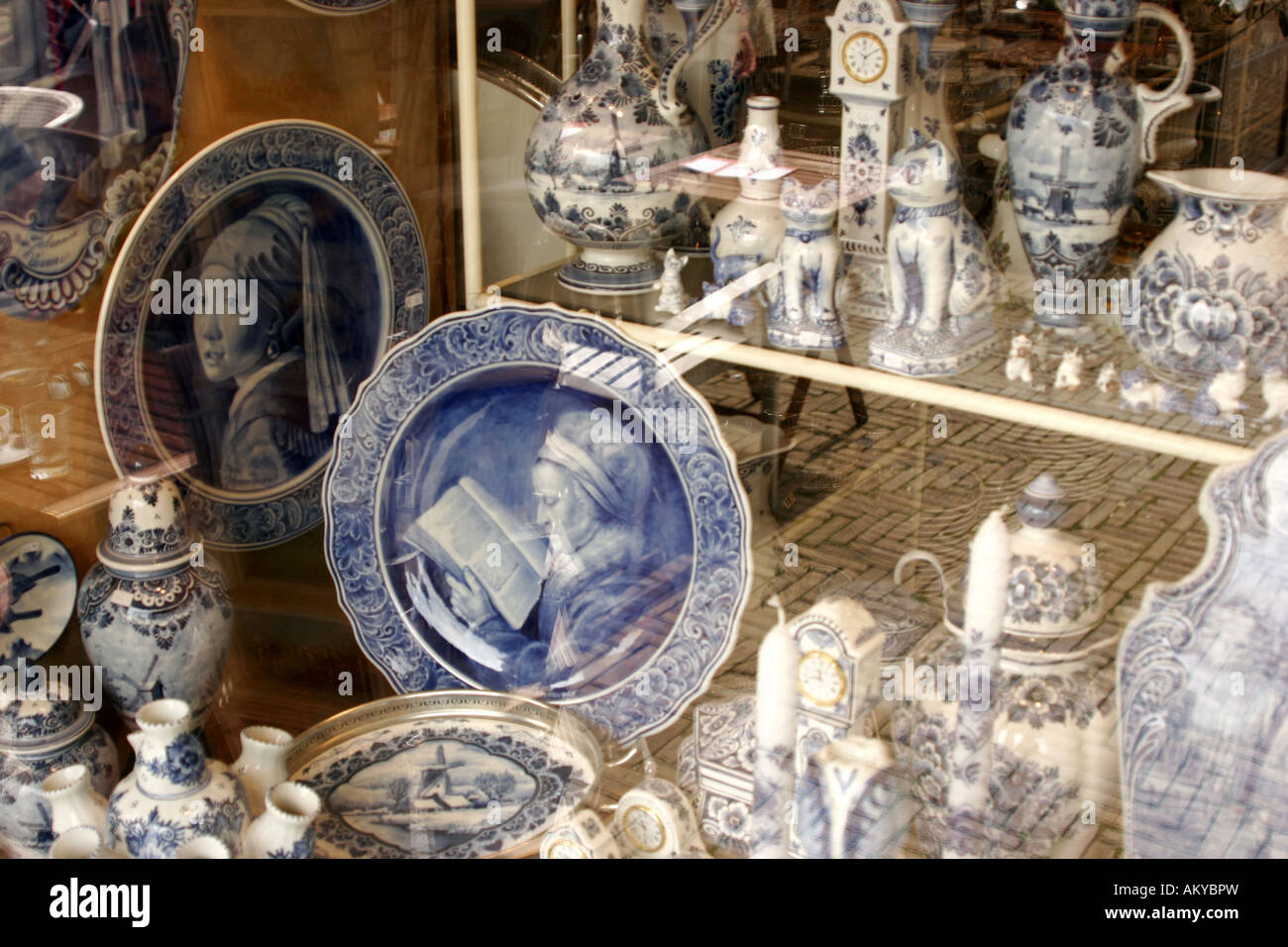 Art and kitsch as souvenirs from Delft . Delftware , or Delft pottery , is blue and white pottery traditionally - Stock Image