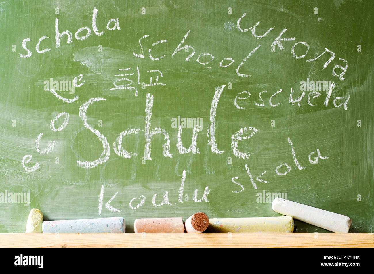 School Internationally, At a blackboard the word school stands written with chalk in many languages, german, france, - Stock Image