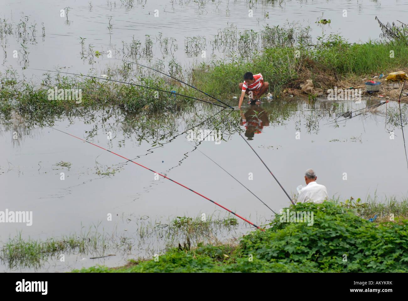 Fisher at the Minjiang River near Leshan near Chengdu, China, Asia - Stock Image