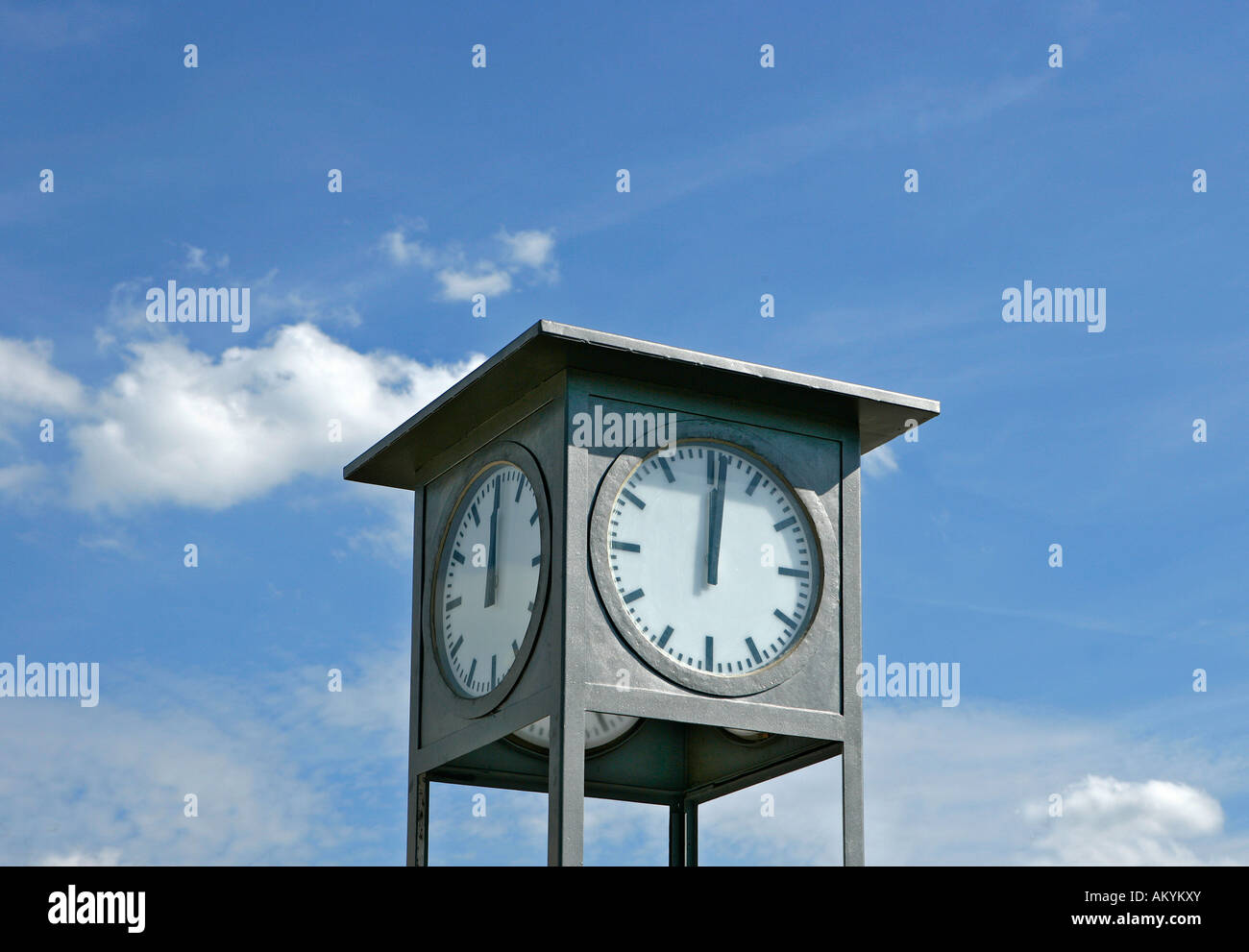 Clock showing 1 minute past 12 noon Stock Photo: 15100274 - Alamy