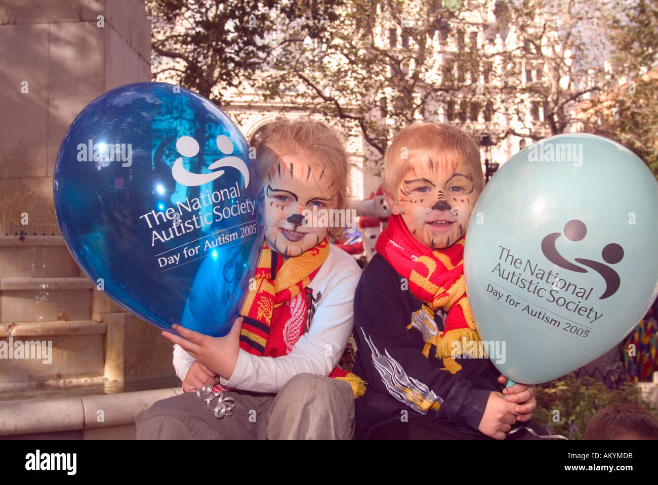 Two youngsters with balloons at a National Autistic Society (NAS) fun day, Leicester Square, London, UK. September 2005. - Stock Image