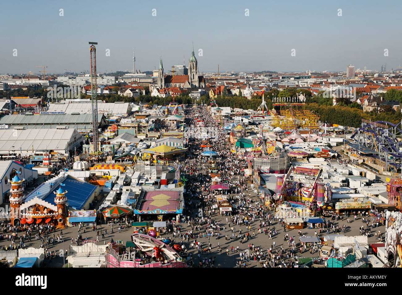Thousands of people are walking over the Theresienwiese on the Munich Oktoberfest Bavaria Germany - Stock Image