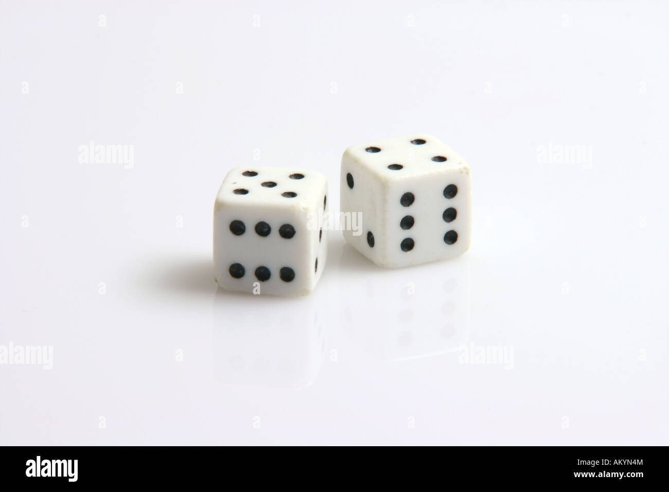 tow six dices on white background toys and leisure items - Stock Image