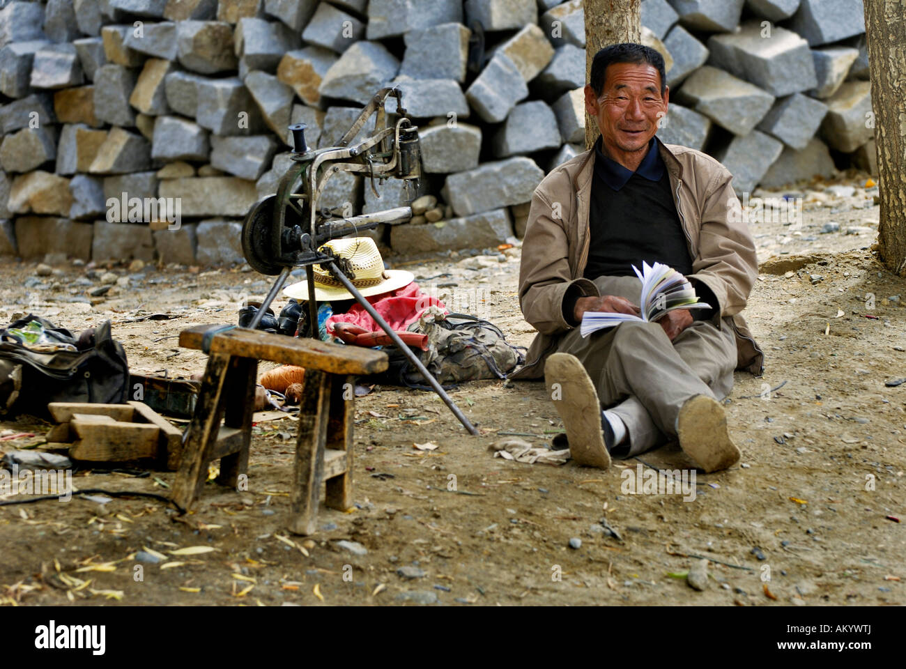 Tibetan with archaic sewing machine, Samye near Lhasa, Tibet, Asia - Stock Image