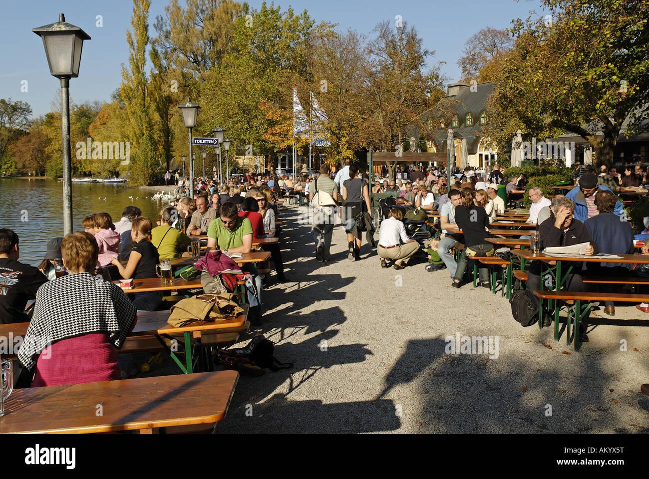 Biergarten, beer garden, at Seehaus, Kleinhesseloher See, Englischer Garten, English Garden, Munich, Bavaria, Germany - Stock Image