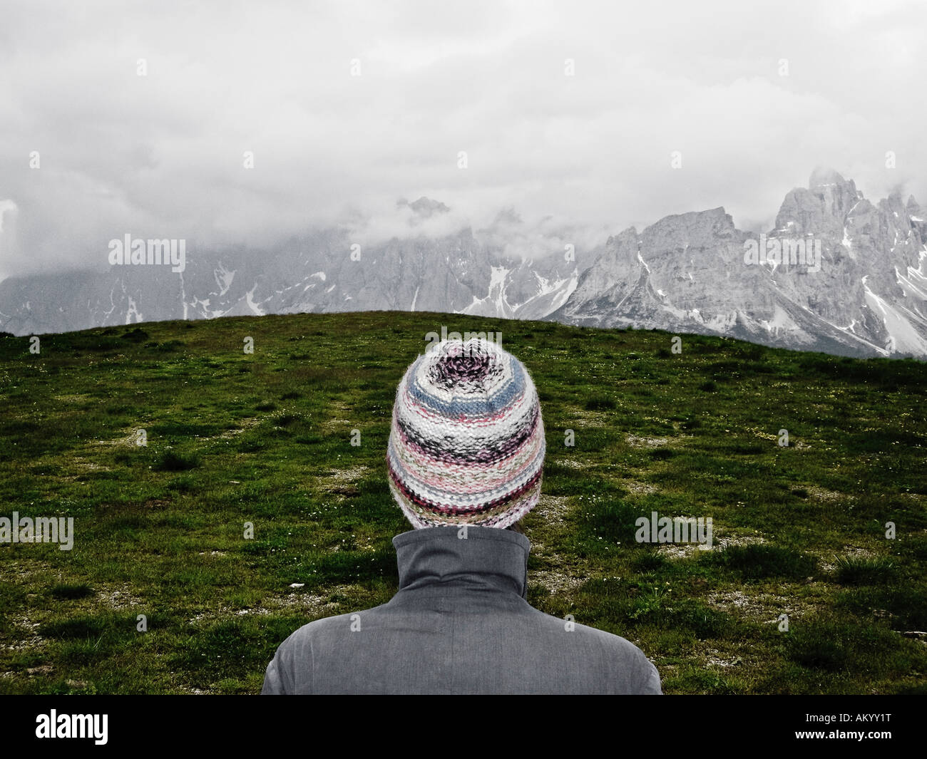 Woman Standing In Front Of Alpine Landscape Dolomites Southern Tyrol Italy - Stock Image