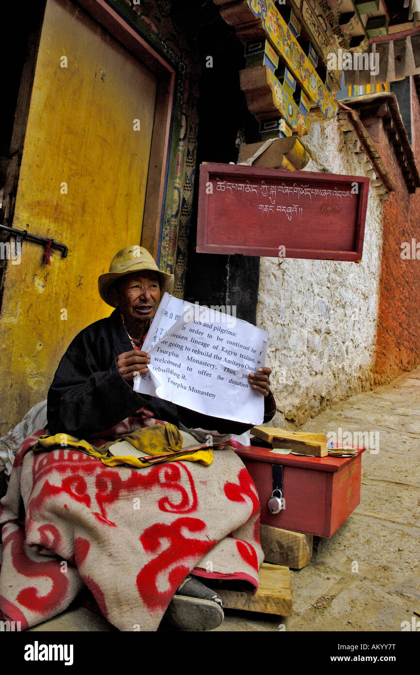 Monk with request, Tshurpu Convent near Lhasa, Tibet - Stock Image