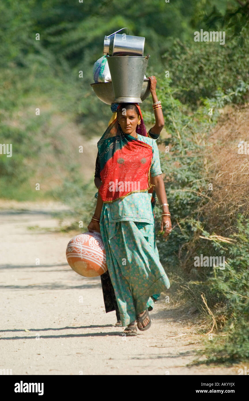 Dalit, or untouchable caste, women carry water outside the village of Nimaj in central Rajasthan, India. - Stock Image