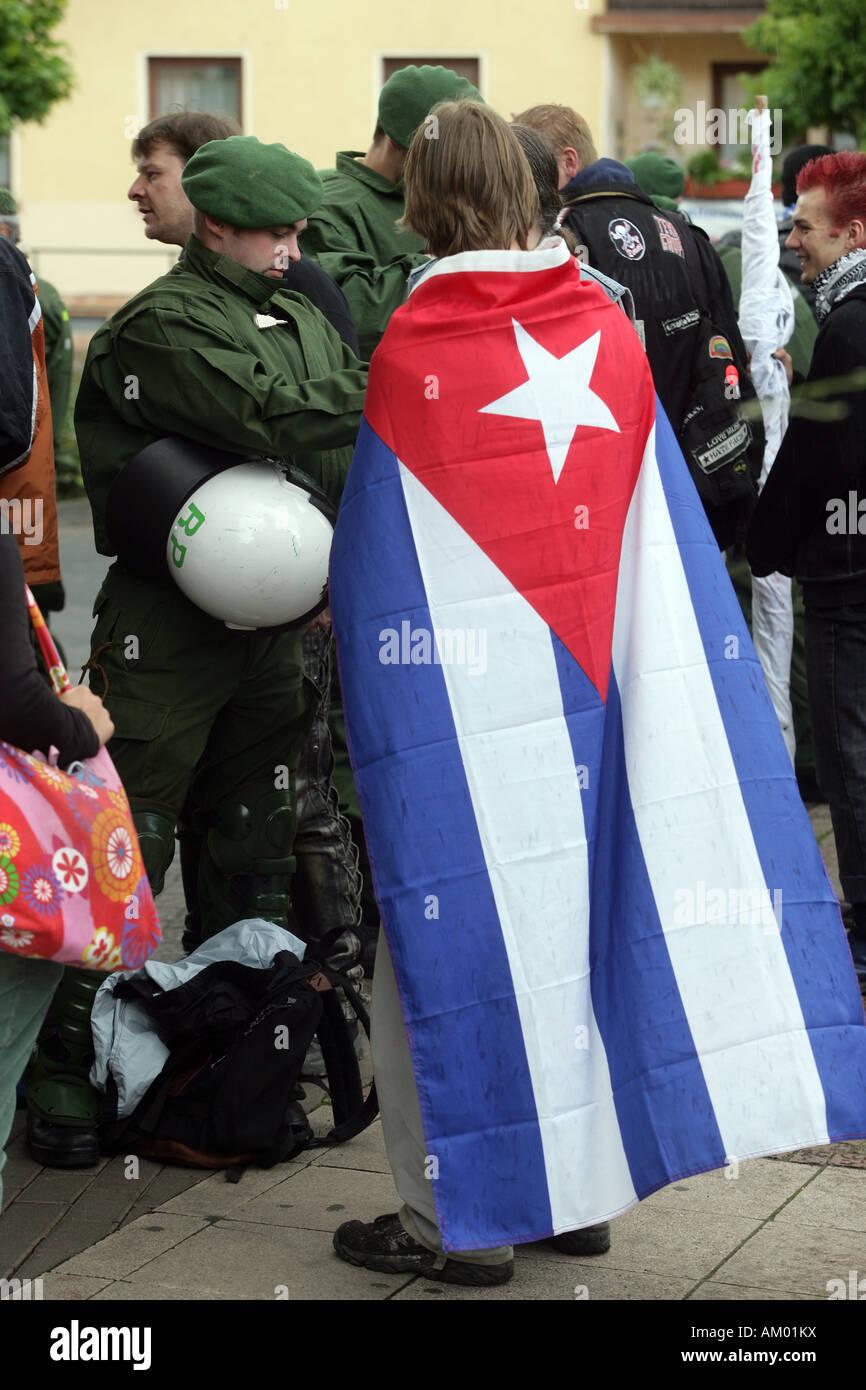 Policeman checks a demonstrator - Stock Image