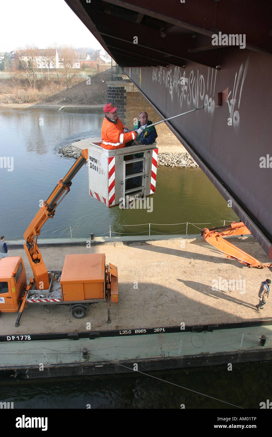 Office of Municipal Sanitation and Renovation cleanse Graffiti from a bridge in Koblenz with an elevating platform - Stock Image