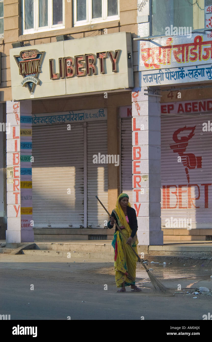 A Dalit, or untouchable, woman sweeps the street in Jodhpur, Rajasthan, India. - Stock Image