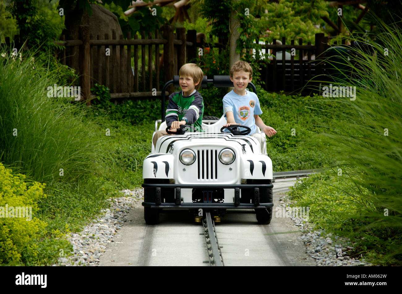Two children are driving with a little car in theme park Legoland, Guenzburg, Germany Stock Photo