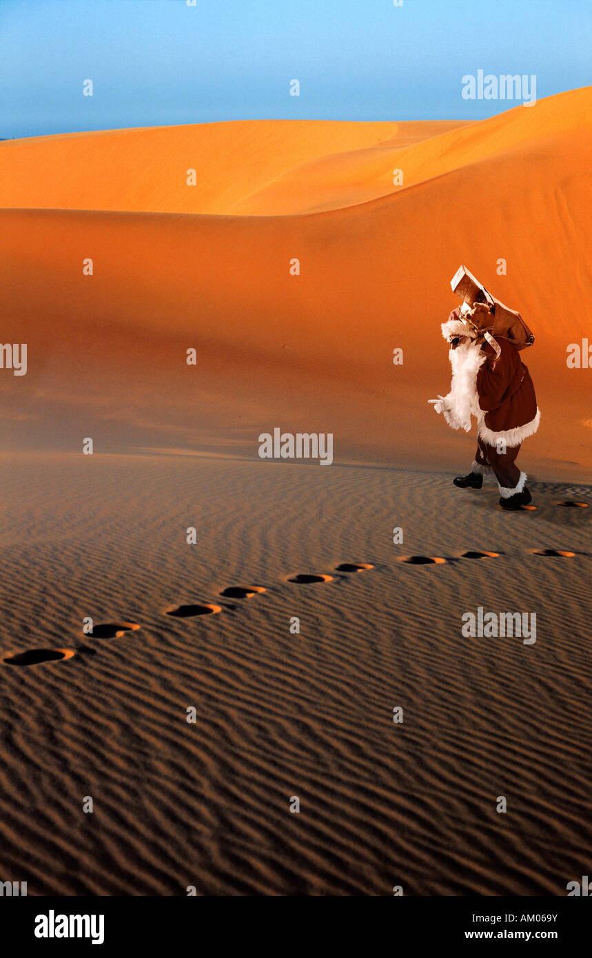 Santa Claus lost in the desert Stock Photo