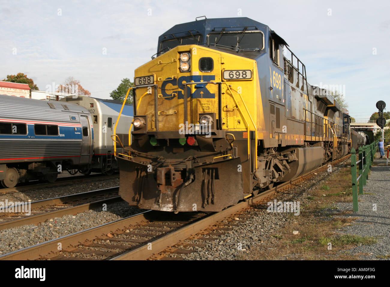 CSX Freight Train passes Amtrak passenger train at Palmer