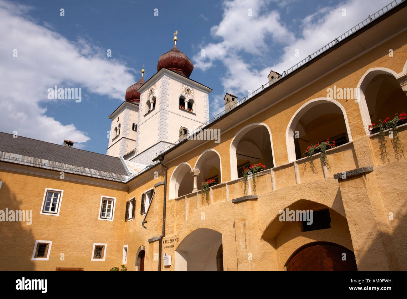 Former monastery Stift Millstatt with steeples of the parish church, Carinthia, Austria - Stock Image