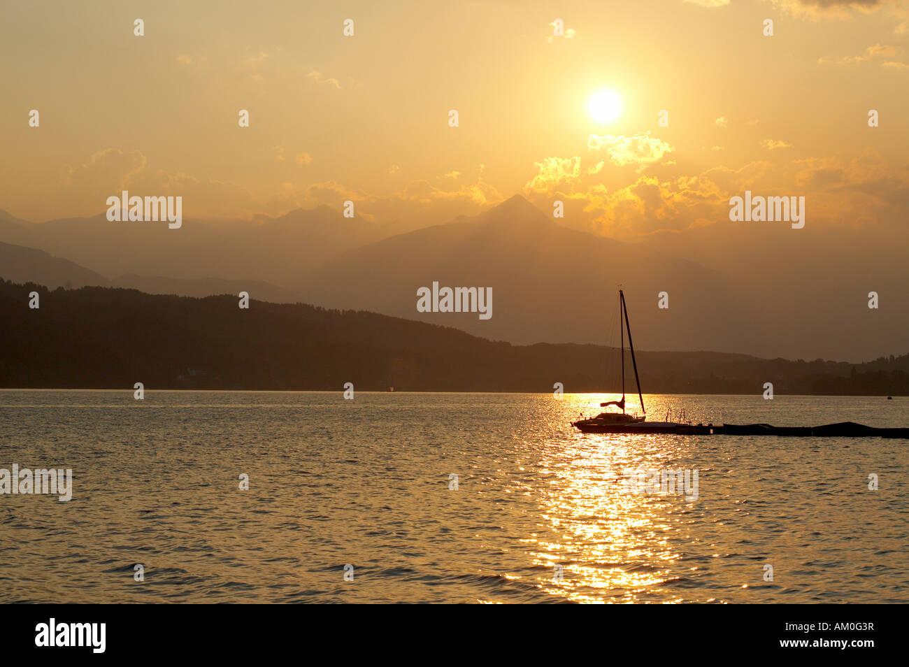 Sailing boats at Lake Millstatt during sunset, Carinthia, Austria Stock Photo