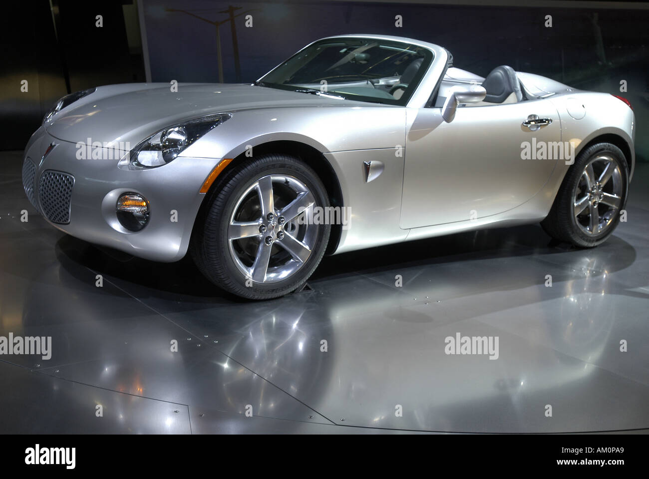 Sports car silver car convertible soft top frog eye wheels wheel trim  - Stock Image