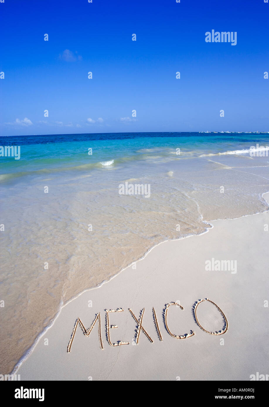 The word MEXICO written on white tropical beach in Playa del Carmen, Cancun, Mexico - Stock Image