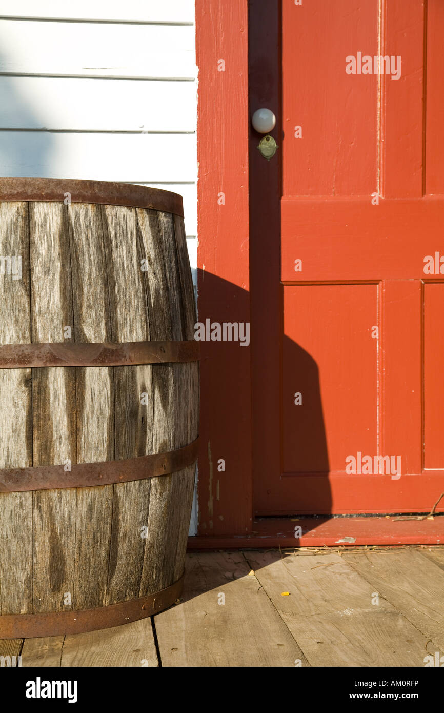 ILLINOIS Galena Wooden barrel next to red door entrance to building at Ulysses S Grant home historic site wood planks - Stock Image