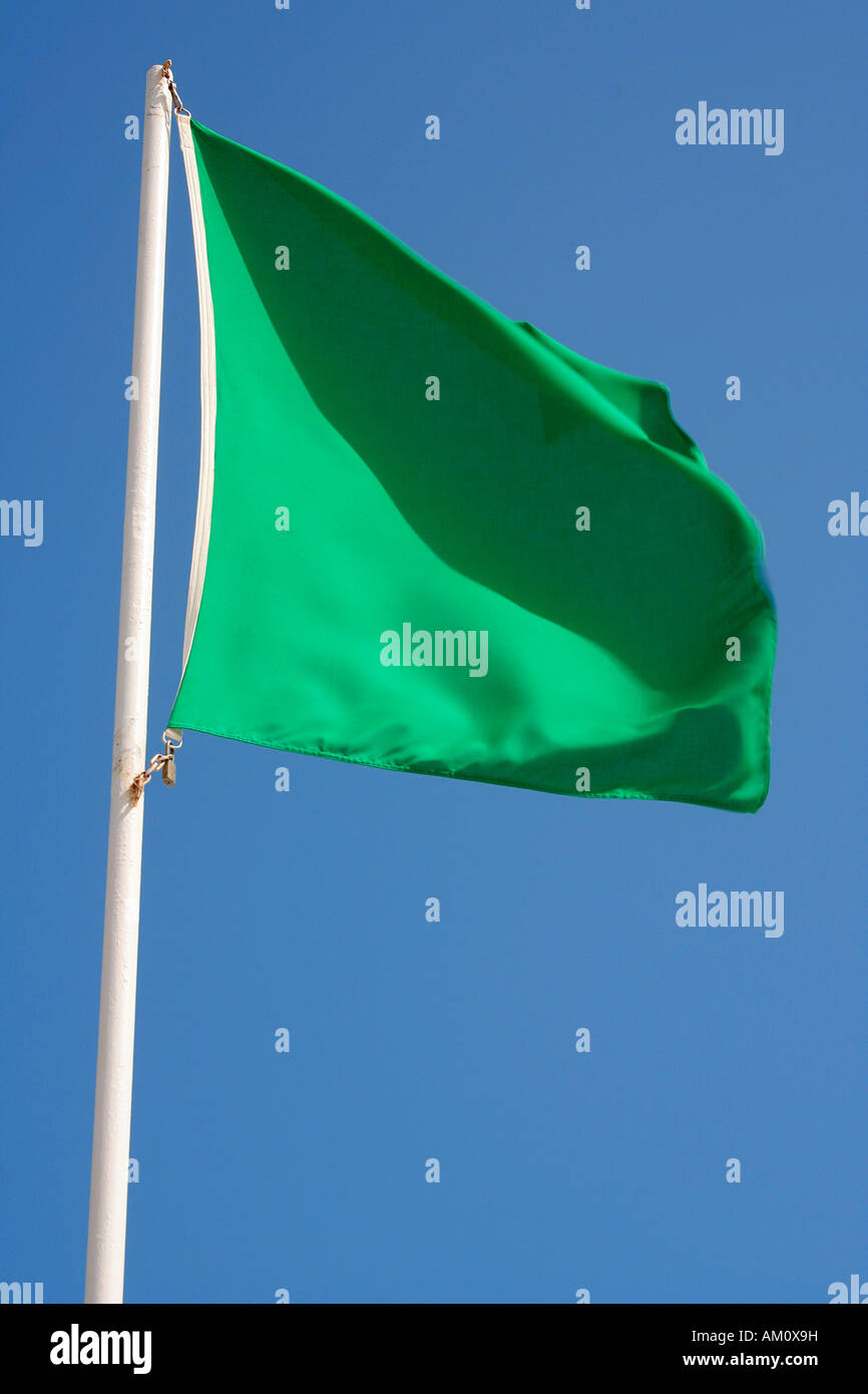 Green flag at bathing beach, bathing permitted - Stock Image