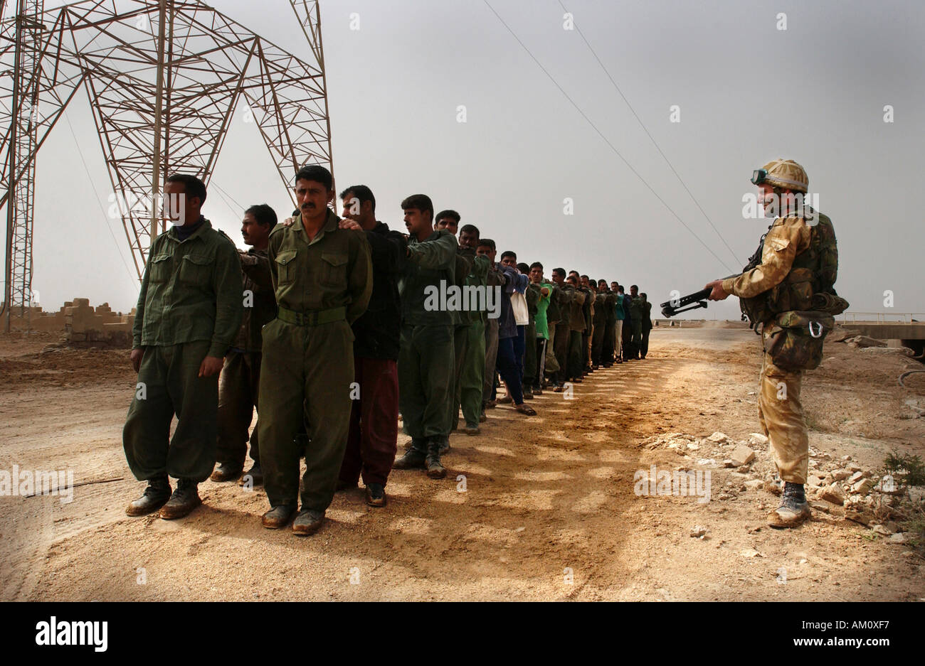 Iraqi Prisoners of War captured on the Al Faw penisular by Royal Marine Commandos on the morning of the invasion. - Stock Image