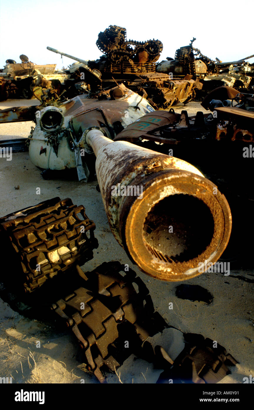 Destroyed Iraqi tanks from Gulf War 1 which lie in the Kuwait desert access forbidden because of the use of depleted uranium. - Stock Image