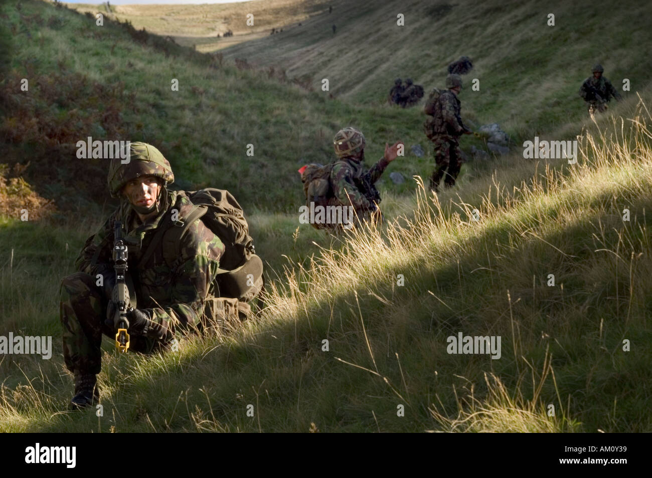 Territorial Army soldiers of the Royal Rifle Volunteers exercising on the Otterburn training area in the Cheviot Hills - Stock Image