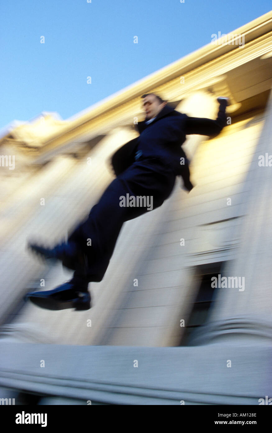 businessman jumping off building stock photo 1315469 alamy