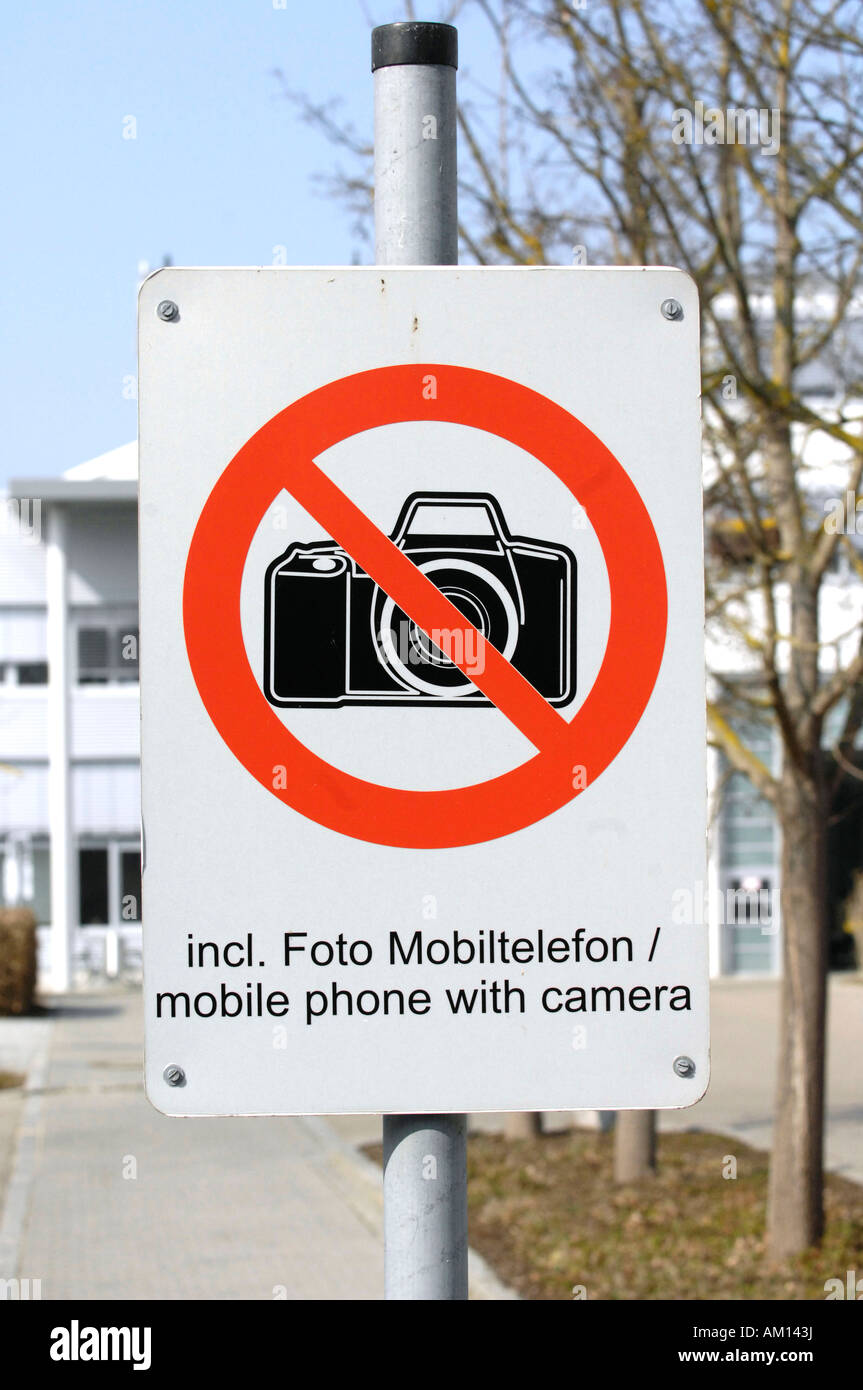 Factory premises - sign: It is restricted to take pictures even with mobile phone'. - Stock Image