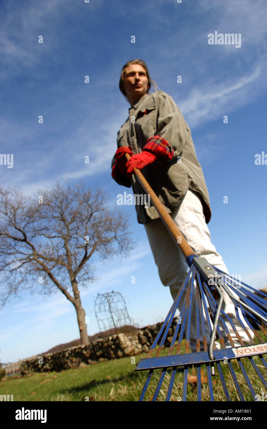 Woman Doing Spring Yard Clean Up - Stock Image