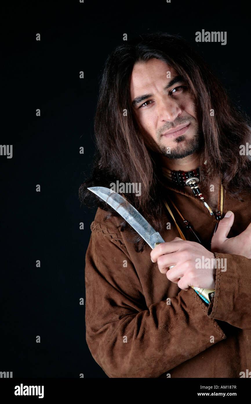 Man wearing indian clothing, knife Stock Photo