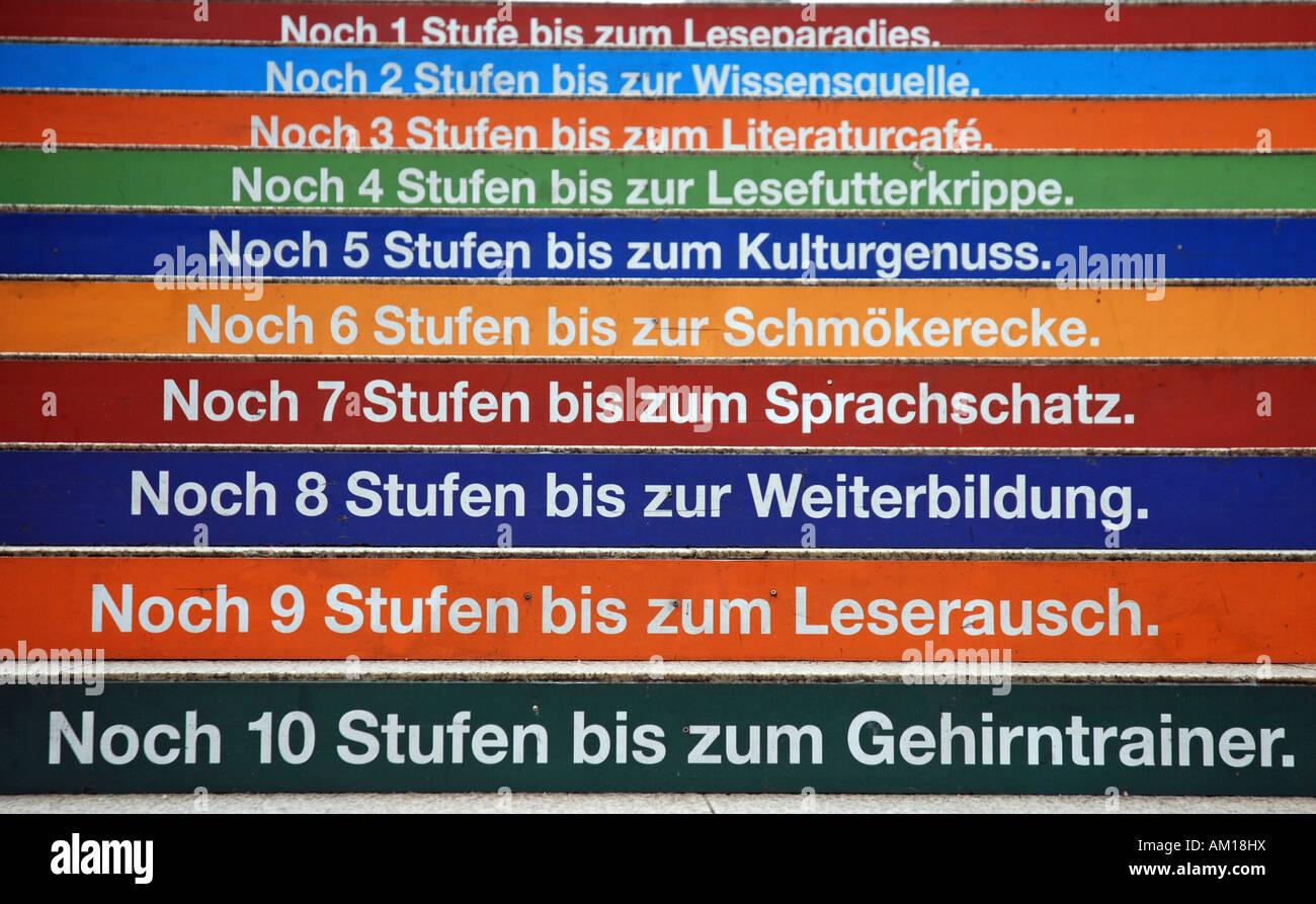 Advertising on steps, Cologne, North Rhine-Westphalia, Germany Stock Photo