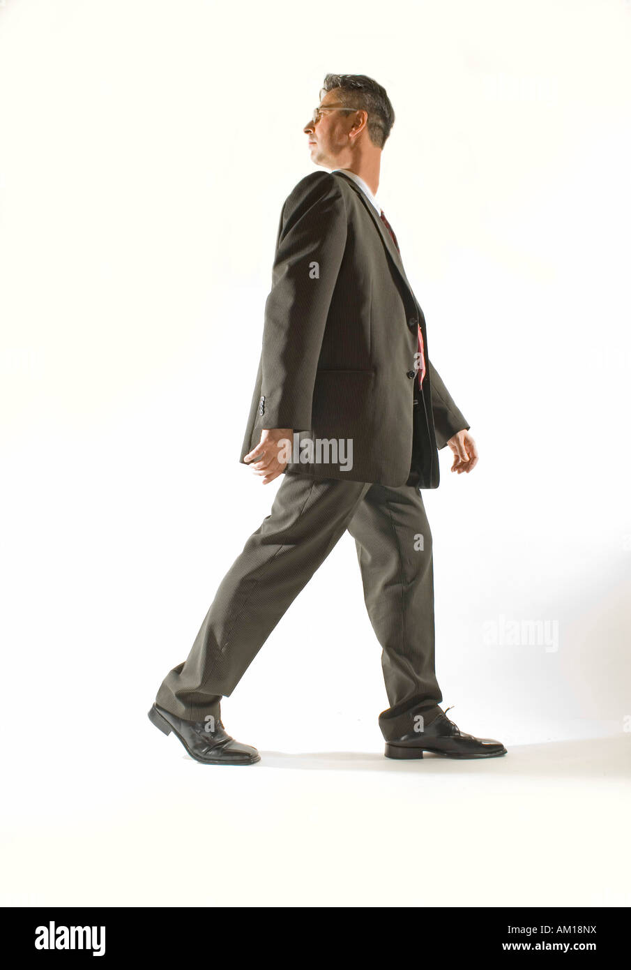 Businessman with turned head - Stock Image