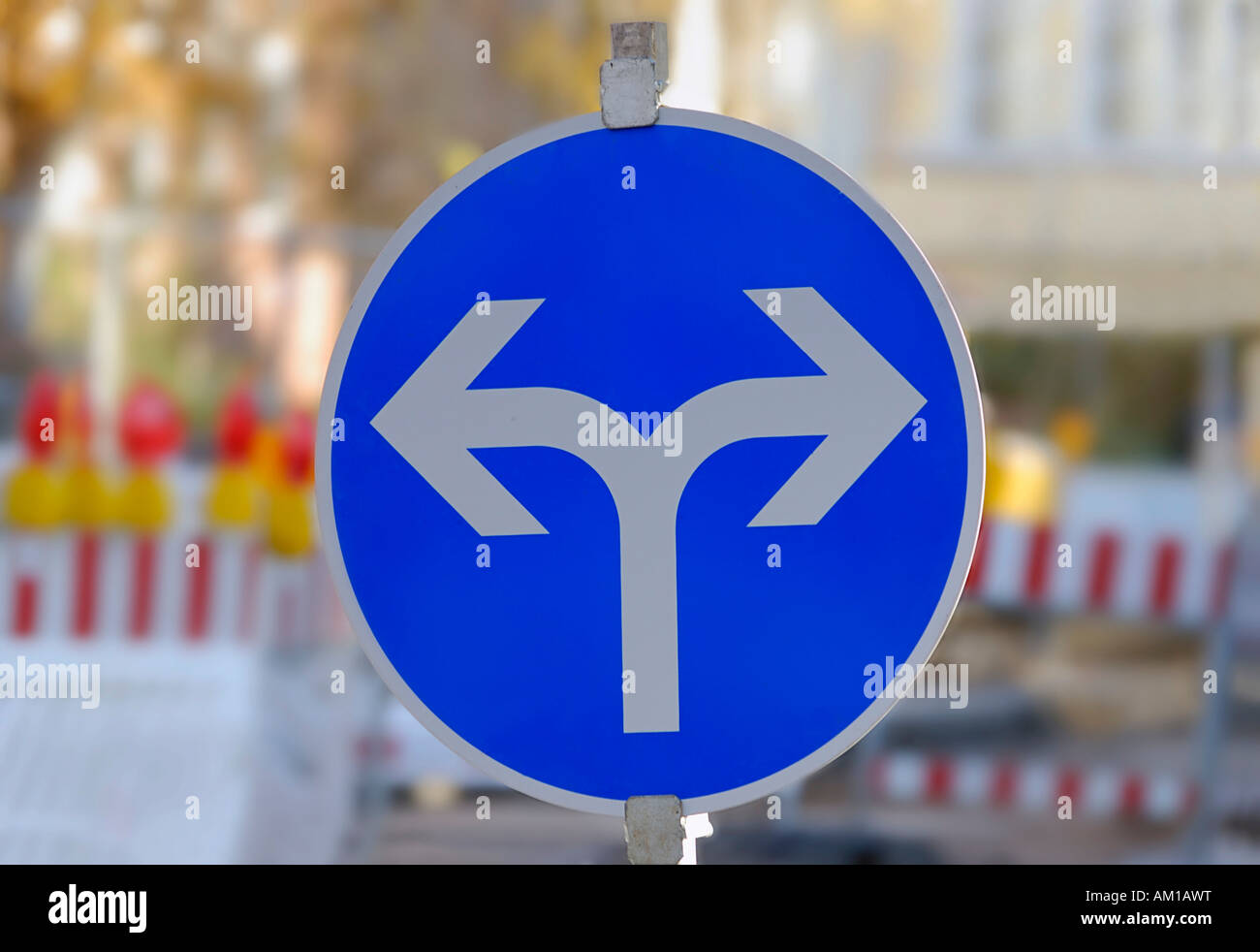 Traffic sign with two directional arrows in order to detour a road construction site - Stock Image