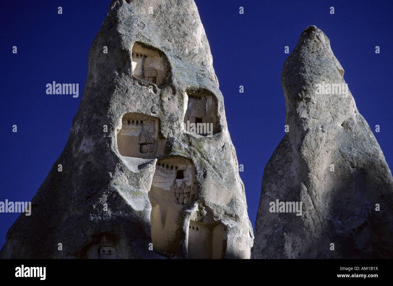Ancient cavern flats near Goereme, Cappadokia, Turkey - Stock Image