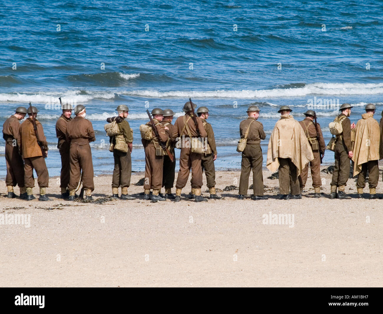 Film extras dressed as WW2 soldiers on the beach at the filming of Atonement a story based on the Dunkirk evacuation - Stock Image