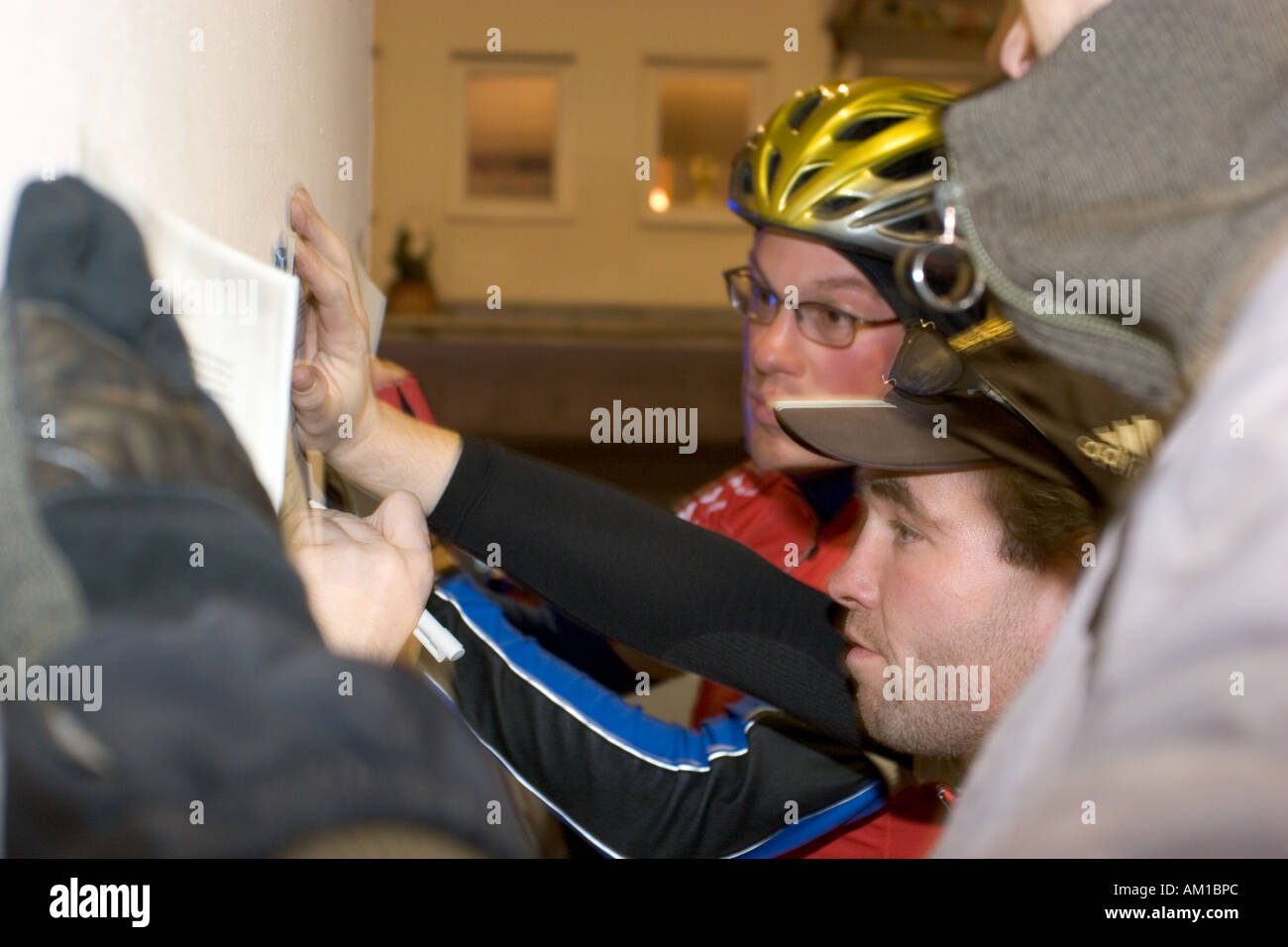night race of bicycle messengers in Germany Bavaria Munich drivers discussing task - Stock Image