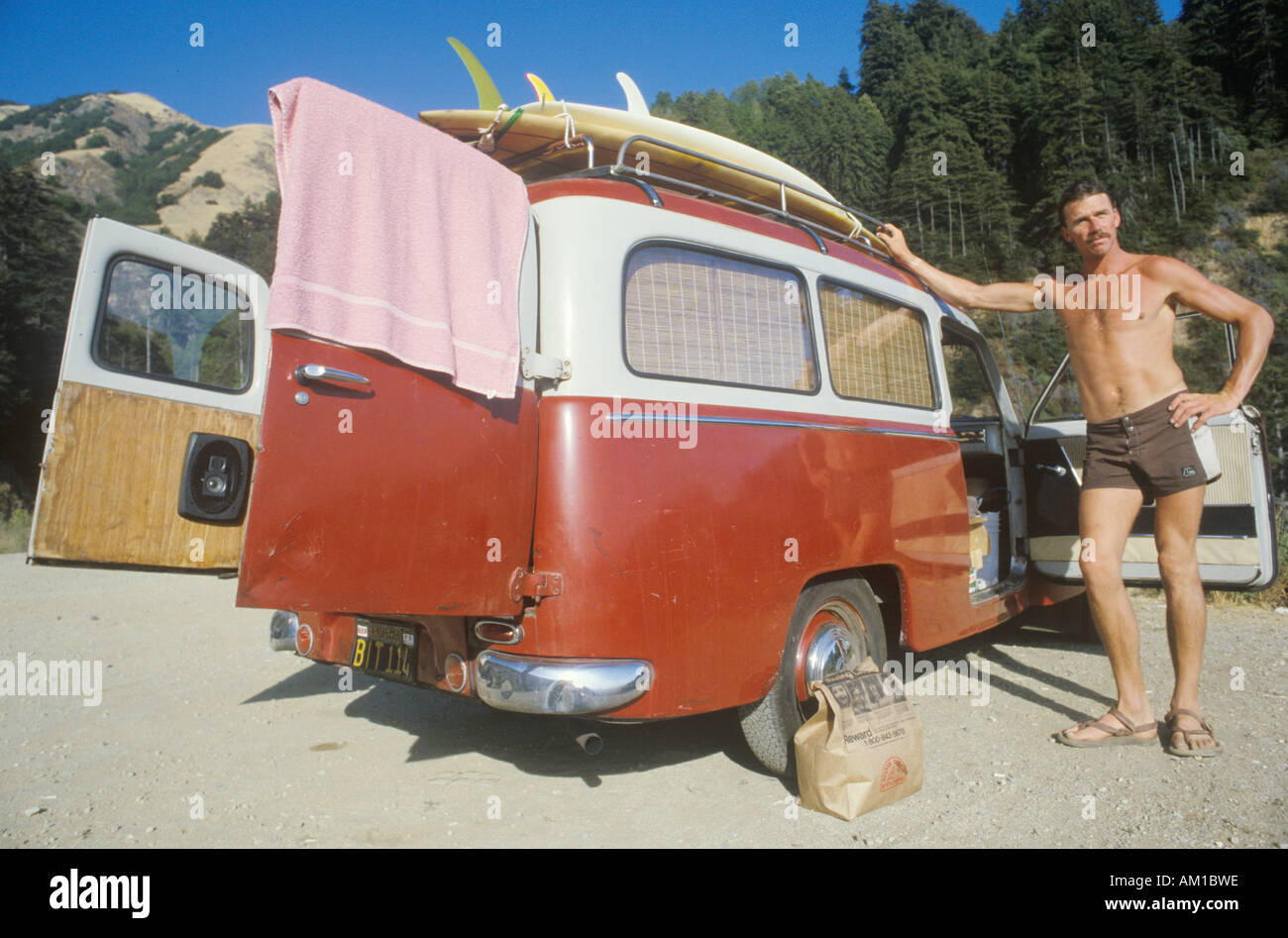 Surfer by VW van Northern CA - Stock Image