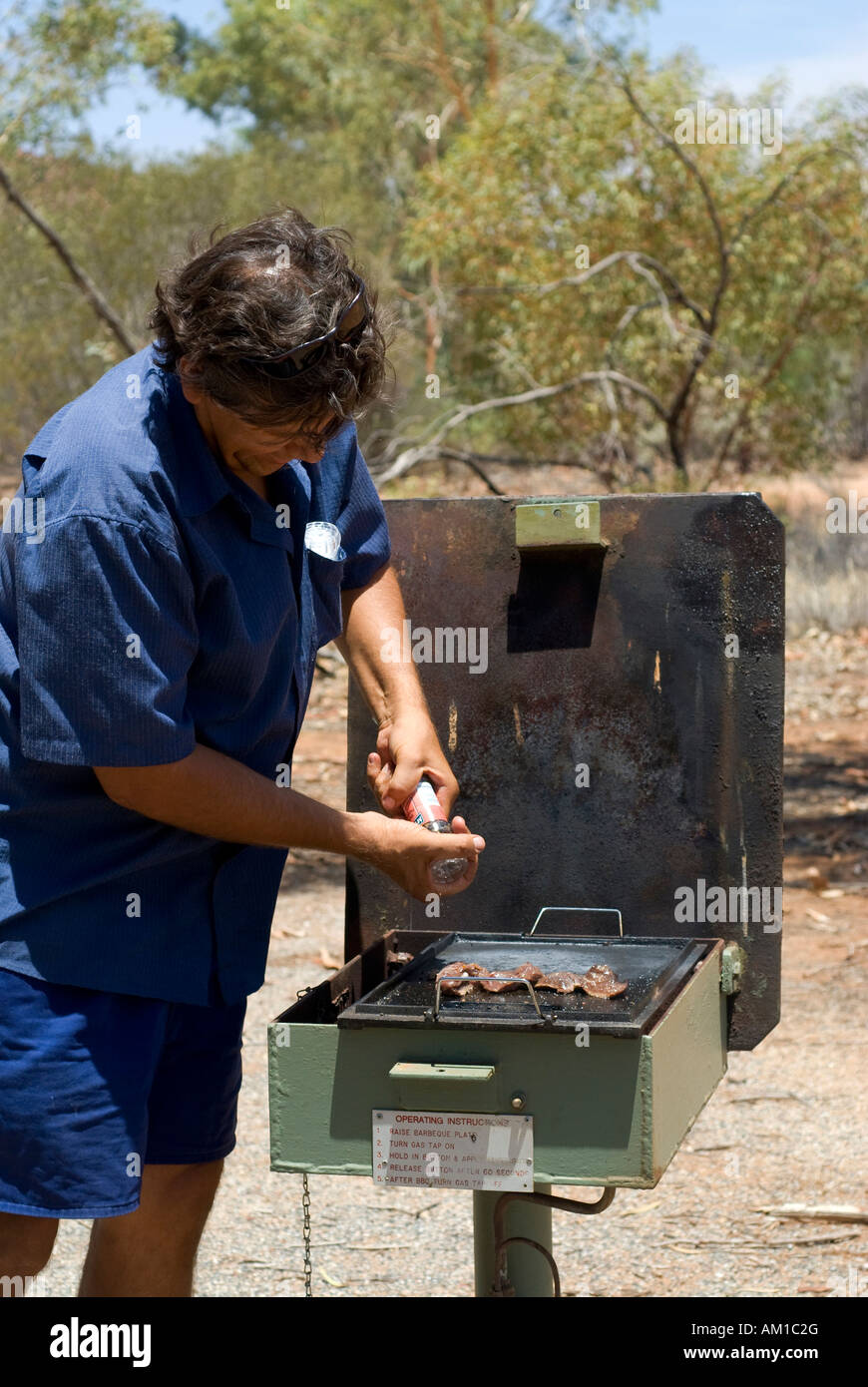 Bush walk with half aboriginal Bob Tailer, barbecue area, Simpsons Gap, West Mac Donell National Park, Alice Springs, - Stock Image