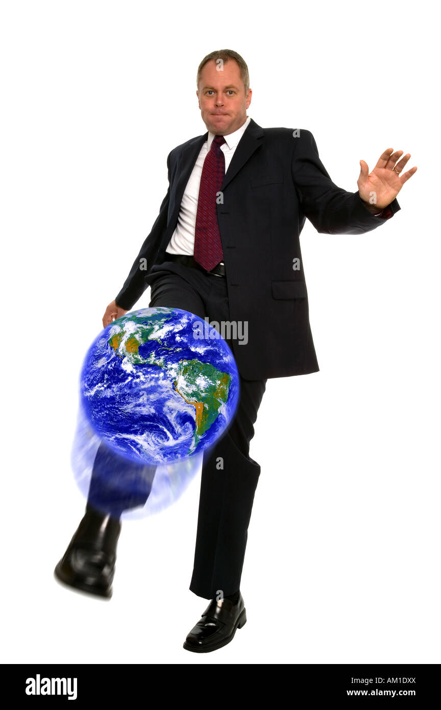 Businessman kicking the world Globe from NASA images Stock Photo