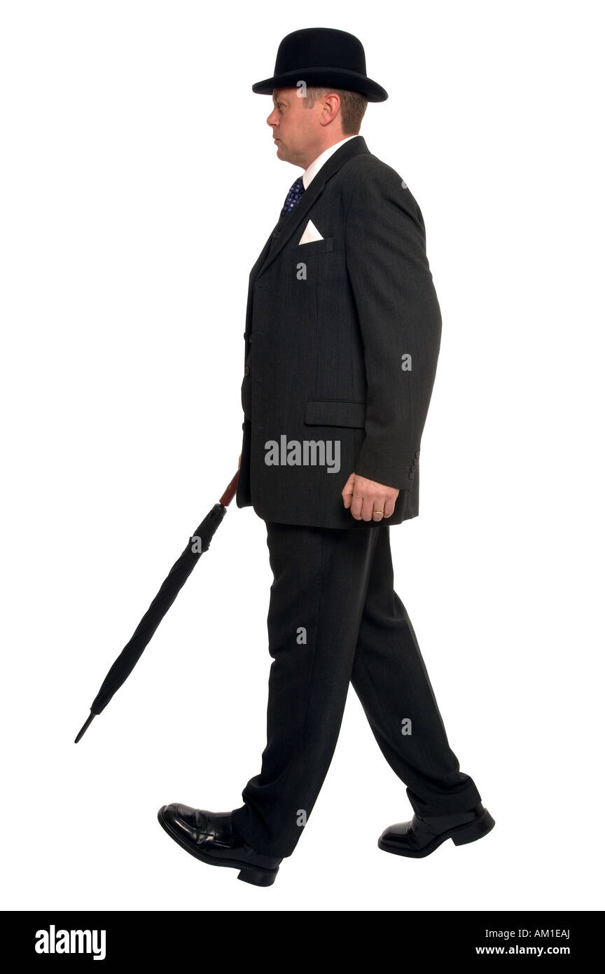 da7d099bf3f City businessman in pin striped suit wearing a bowler hat and carrying an  umbrella as he
