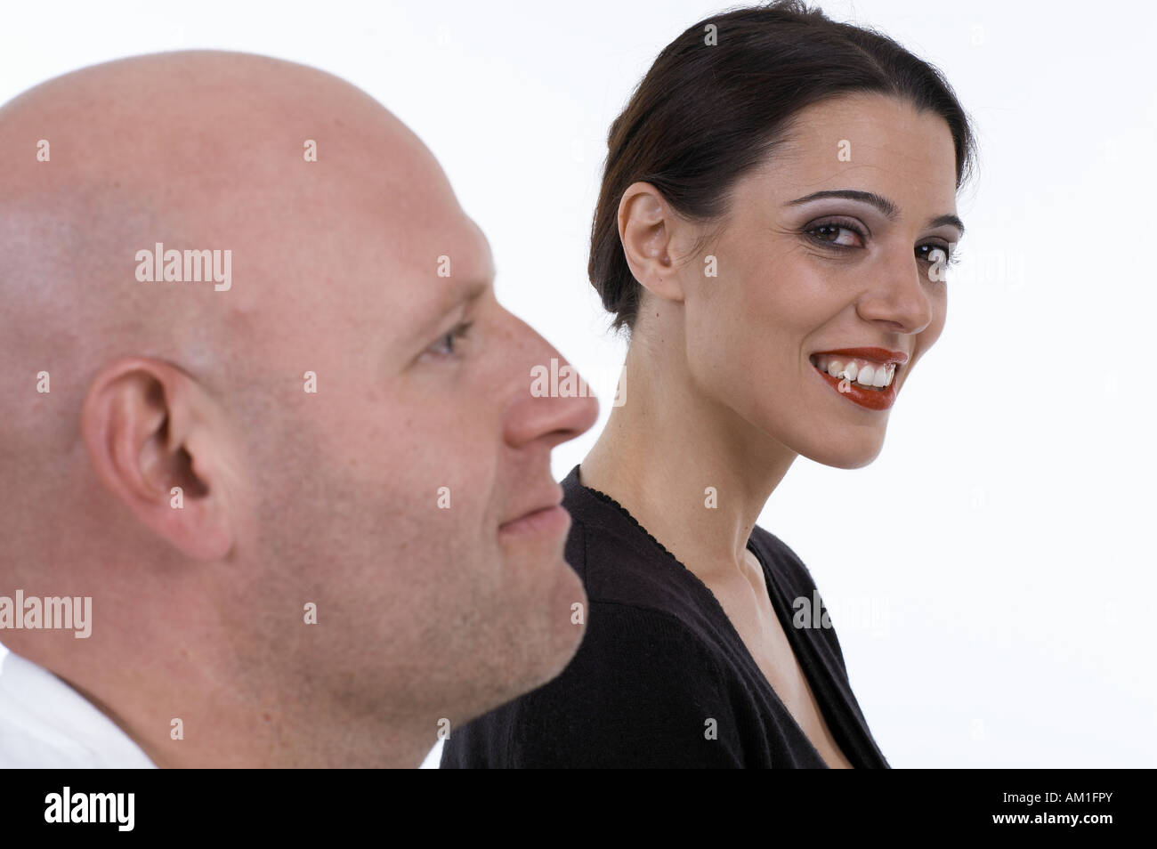 Woman looks coquettish to man - Stock Image