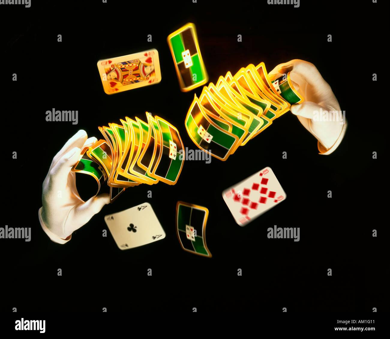 Magician doing card tricks - Stock Image