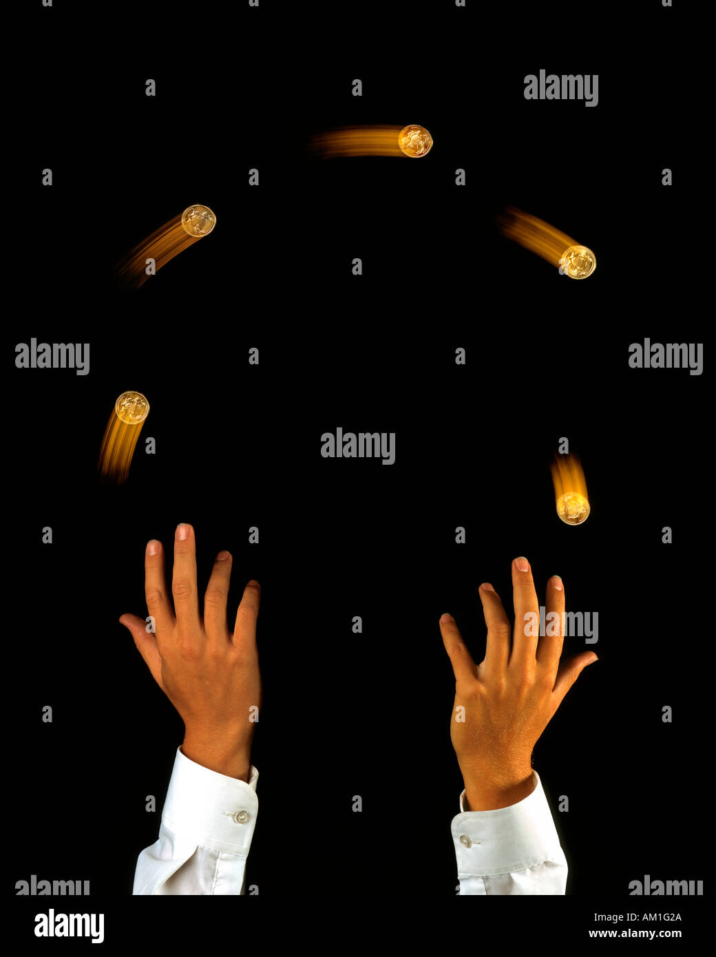 Juggling finances juggler with gold coins - Stock Image