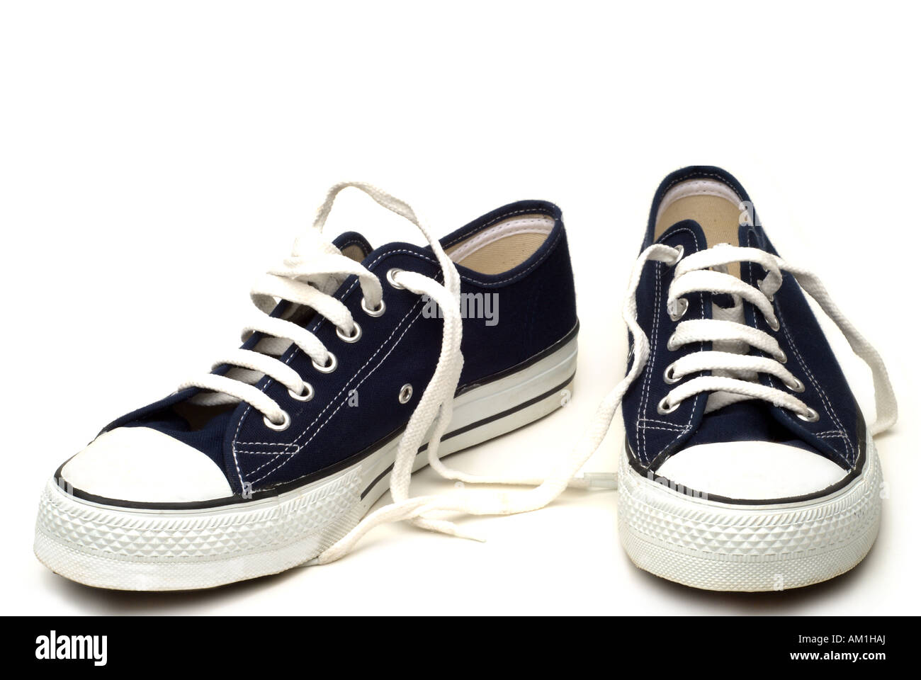 Pair of blue and white classic vintage sneakers shoes isolated - Stock Image